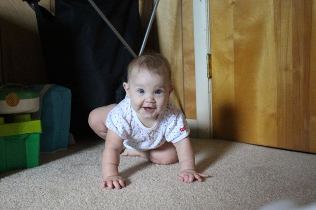 You've been practicing crawling, but it's been more of a scoot until yesterday (Aug. 4th) when you actually crawled forward.