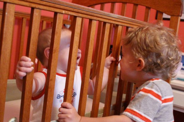 Here you two are plotting your escape from the crib…I fear Finn is a bit too eager to help you. lol