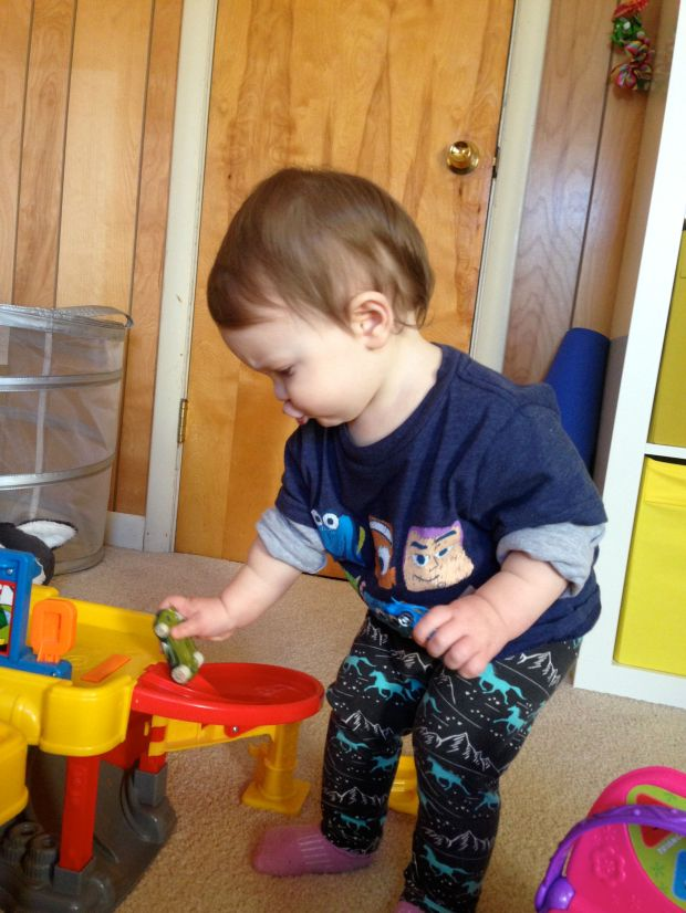 You are very busy, always playing and very rarely sitting still. You borrowed Finn's shirt in this pic and you make it look as cute as he does.